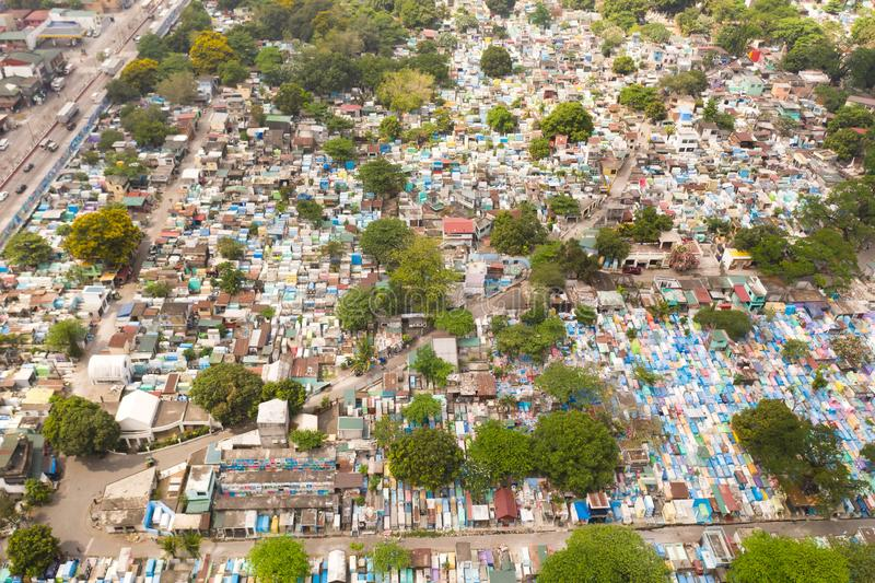 City cemetery in Manila, view from above. Old cemetery with residential buildings. City cemetery in Manila, view from above. Many stone coffins and crypts. Old stock photo