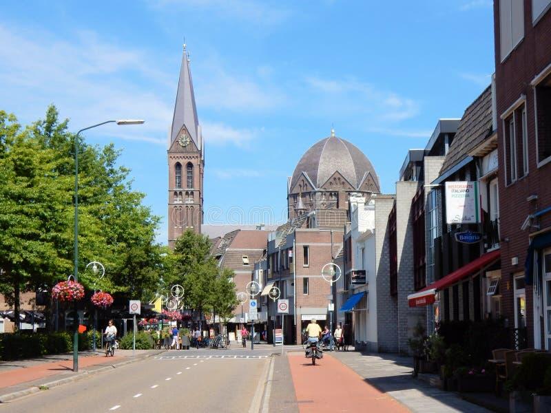 Dutch City center Geldrop with Roman Catholic church. City center Geldrop with St. Brigida church, Roman Catholic church in Romanesque Revival with cruciform royalty free stock image