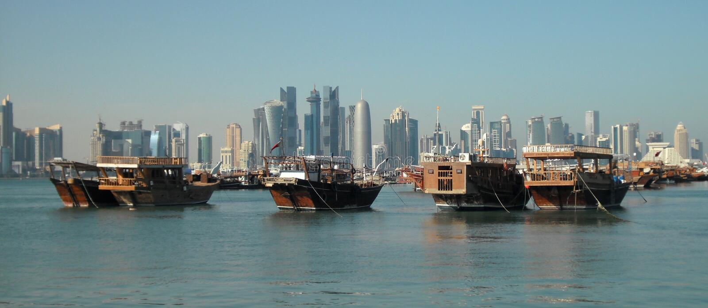 City center and junks, Doha, Qatar. City center and junks by the cornice, Doha, Qatar royalty free stock image