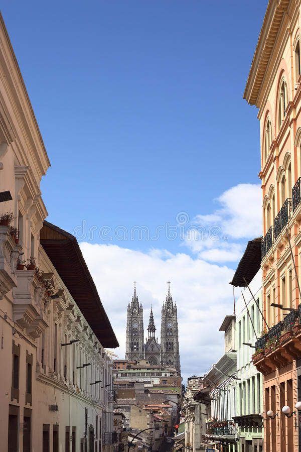 City Center in Quito, Ecuador. QUITO, ECUADOR - AUGUST 4, 2014: Venezuela street with view onto the Basilica del Voto Nacional (Basilica of the National Vow) in royalty free stock photography