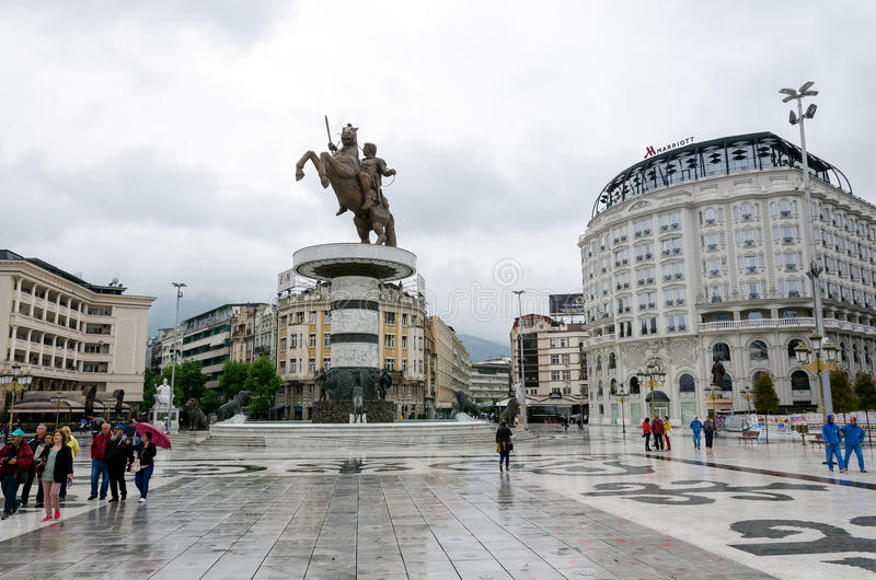 City center of Skopie, Macedonia. In rainy day with the monument of Aleksander the great, few tourists and some of the historic buildings royalty free stock image