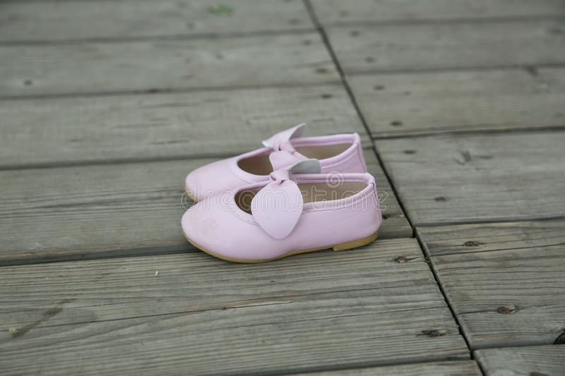 City Cesis, Latvian Republic. Pink baby booties stand on a wooden floor. July 14 2019. Travel photo stock photos