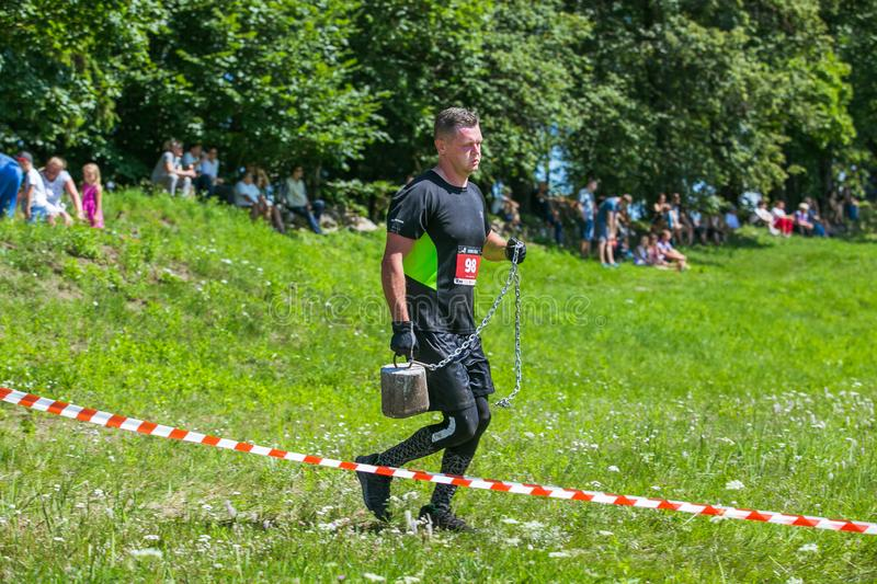 City Cesis, Latvian Republic. Run race, people were engaged in sports activities. Overcoming various obstacles and running.  July. City Cesis, Latvian Republic stock images