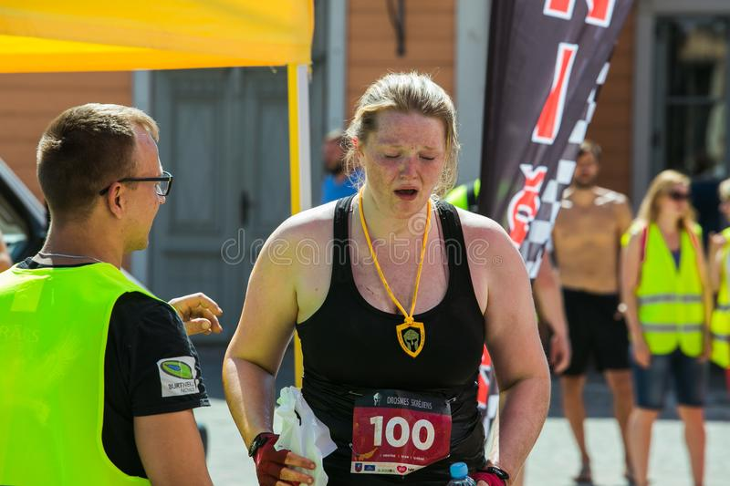 City Cesis, Latvian Republic. Run race, people were engaged in sports activities. Overcoming various obstacles and running.  July. City Cesis, Latvian Republic royalty free stock images