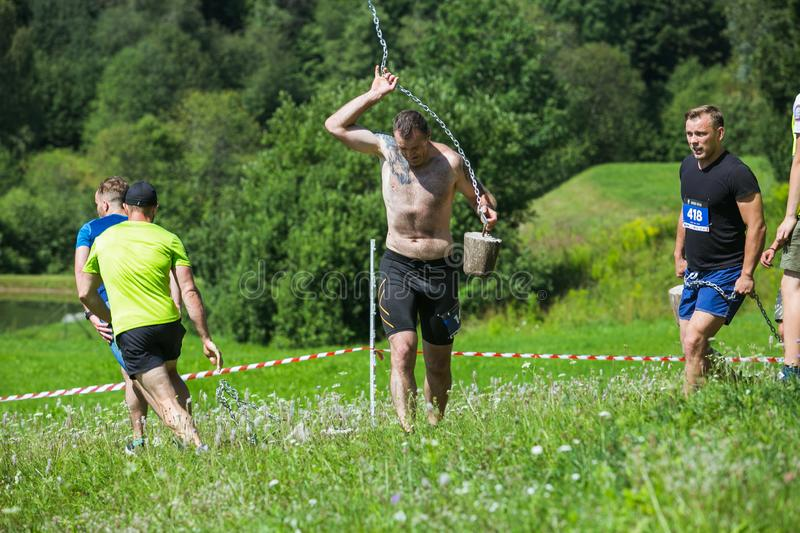 City Cesis, Latvian Republic. Run race, people were engaged in sports activities. Overcoming various obstacles and running.  July. City Cesis, Latvian Republic stock photos