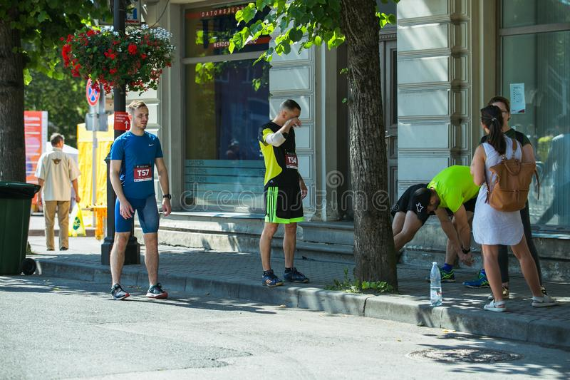 City Cesis, Latvian Republic. Run race, people were engaged in sports activities. Overcoming various obstacles and running.  July. City Cesis, Latvian Republic stock photography