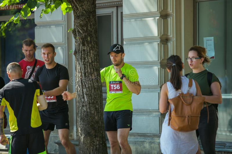 City Cesis, Latvian Republic. Run race, people were engaged in sports activities. Overcoming various obstacles and running.  July. City Cesis, Latvian Republic stock image