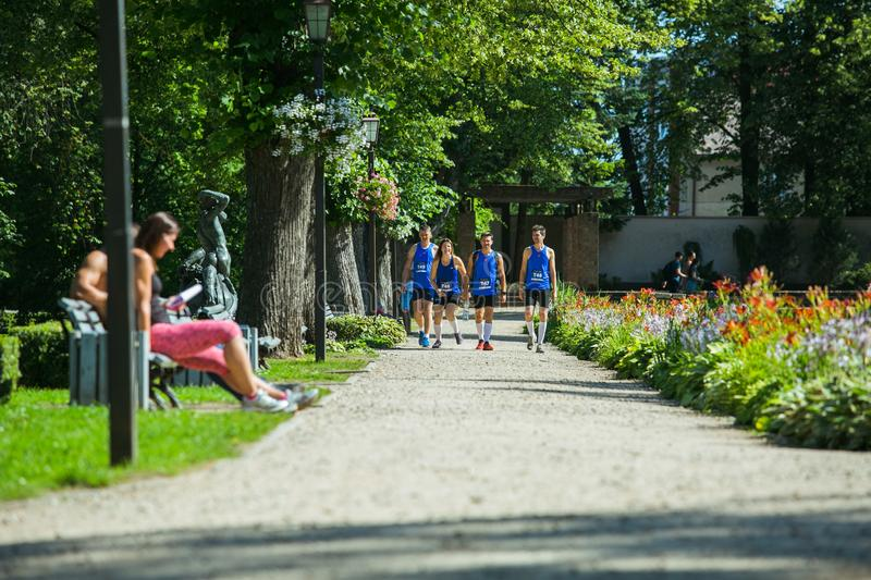 City Cesis, Latvian Republic. Run race, people were engaged in sports activities. Overcoming various obstacles and running.  July. City Cesis, Latvian Republic stock photo