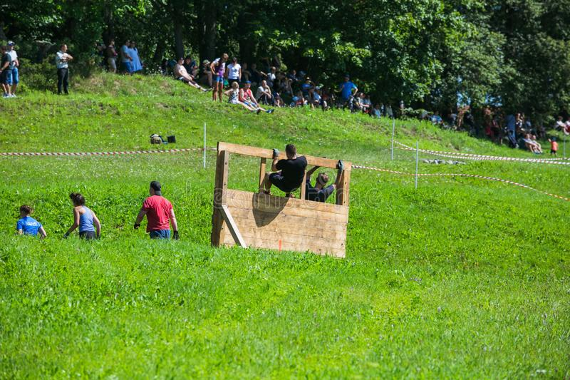 City Cesis, Latvian Republic. Run race, people were engaged in sports activities. Overcoming various obstacles and running.  July. City Cesis, Latvian Republic royalty free stock photography