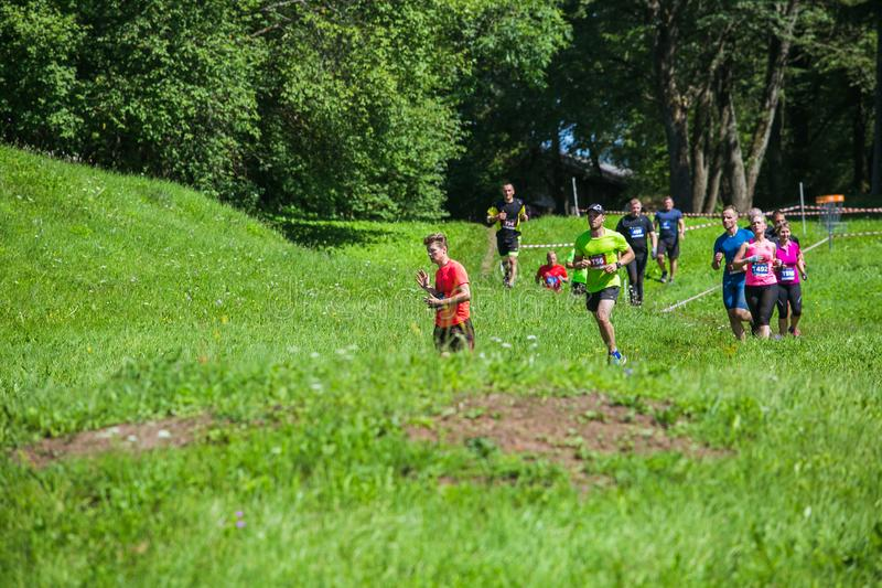 City Cesis, Latvian Republic. Run race, people were engaged in sports activities. Overcoming various obstacles and running.  July. City Cesis, Latvian Republic royalty free stock photo