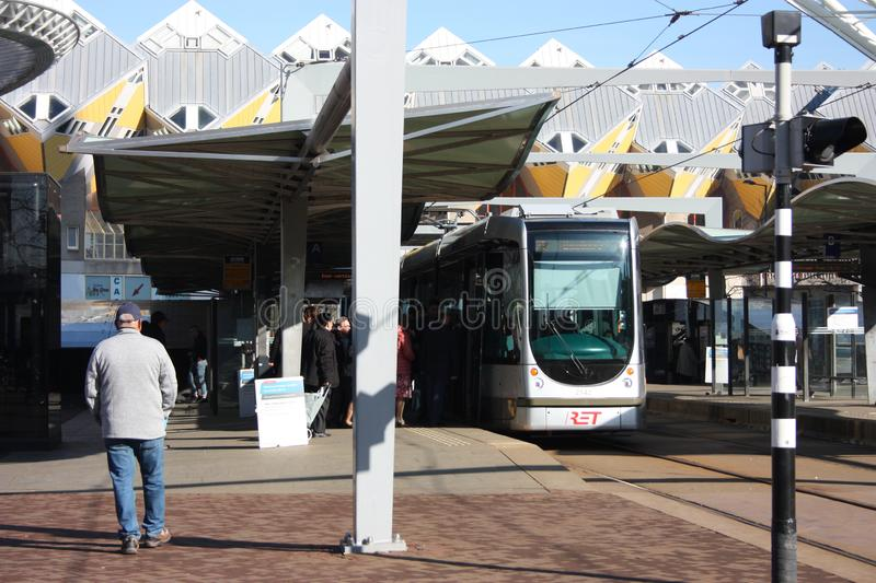 Daily city chaos in the hectic and modern station of the metropolis of Rotterdam. Yellow cubic houses are the decoration of the royalty free stock image