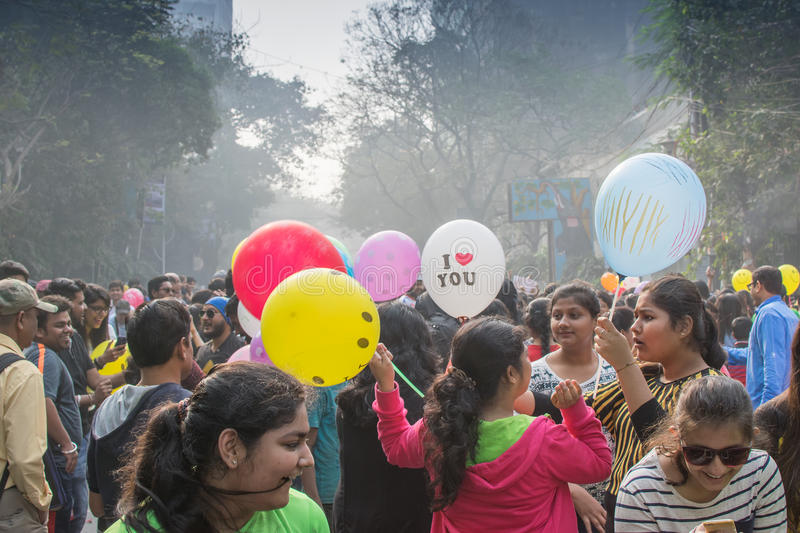 City childrens having fun with colourful balloons. KOLKATA, WEST BENGAL, INDIA - FEBRUARY 7TH 2016 : City children celebrating `Happy Street` event on Park royalty free stock photo