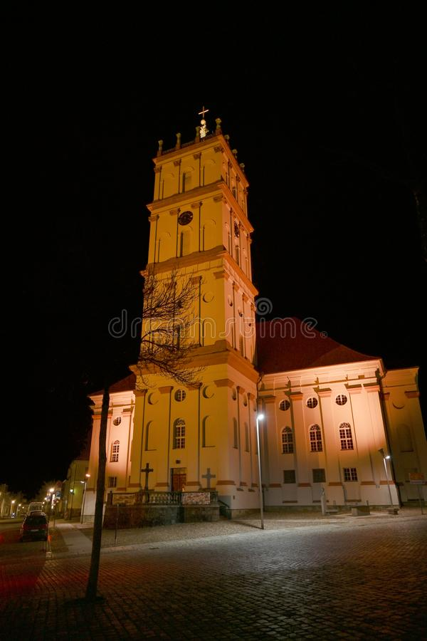 City Church of Neustrelitz illuminated at night on the market place, cityscape with copy space in the black sky, Mecklenburg-. Vorpommern, Germany stock images