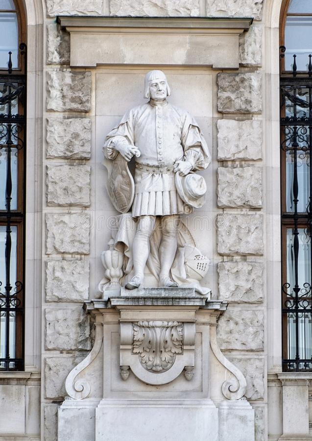 City Citizens or Citizen by Emmerich Alexius Swoboda of Wikingen, Neue Burg or New Castle, Vienna, Austria. Pictured is one of twenty statues on the faç royalty free stock photos