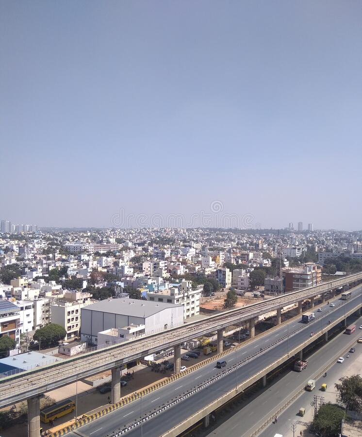 City Cityscape illuminated aerial view Road high angle view Traffic illuminated Stadium sky Architecture  in Banglore India royalty free stock image