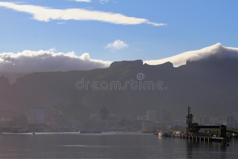 City on coast in shadow of mountain ridge. Port Louis, Mauritius;. 22-01-2016 royalty free stock image