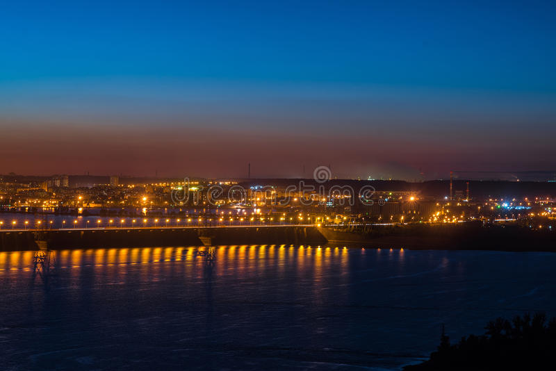 City with dam. Panorama of city Tolyatti at night with river Volga with lights of dam royalty free stock photography
