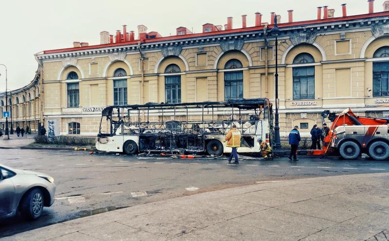 St Petersburg architecture history building bus car fire incident road transportation. City day road transportation car bus fires scene royalty free stock image