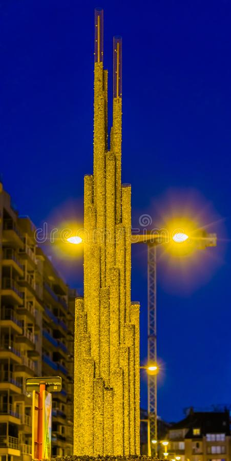 City decoration, simple art work made out of mesh cylinders filled with shiny rocks, cylinders in different sizes royalty free stock photo