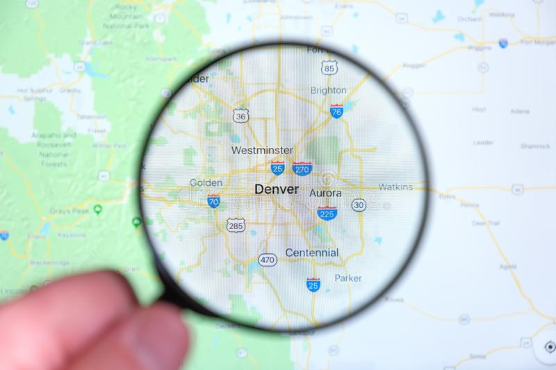 City of Denver, Colorado on the display screen through a magnifying glass royalty free stock image