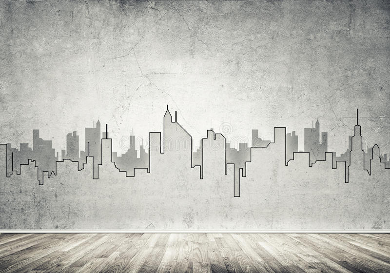 City design on wall. Silhouette of modern city landscape drawn on concrete wall royalty free stock images