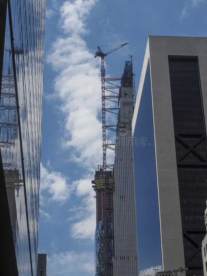 City development. New building construction in Manhattan, NY with blue sky on background stock image