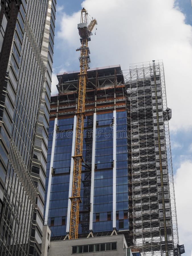 City development. New building construction in Manhattan, NY with blue sky on background royalty free stock photos