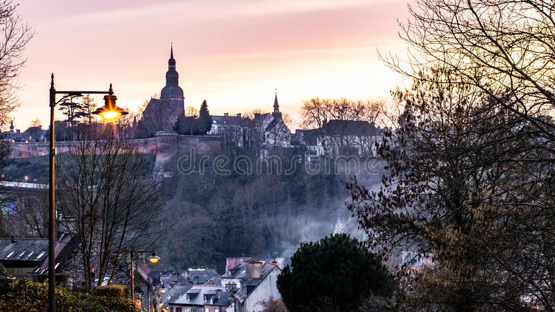 The city of Dinan and its ramparts. Twilight view of the city of Dinan and its ramparts, Brittany, France royalty free stock photography