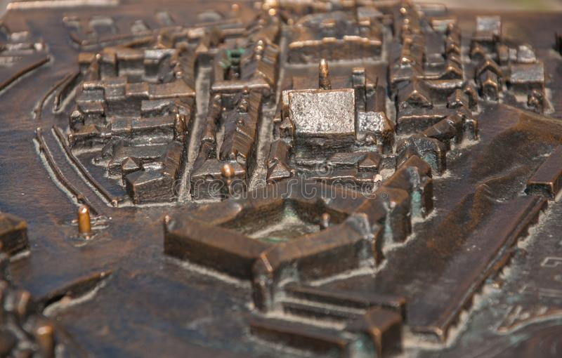Bronze miniature of the city stock image