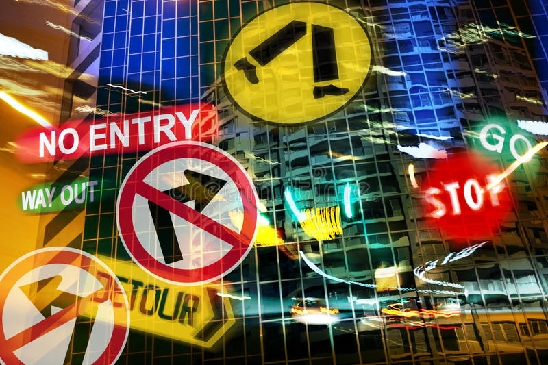 City Driving Nightmare. Road signs against a city background at night royalty free stock photography