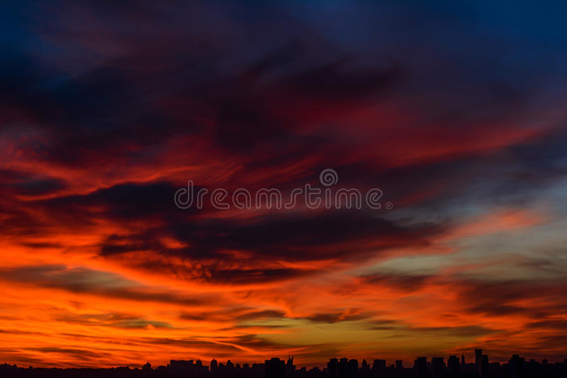 City at fiery sunset stock photo