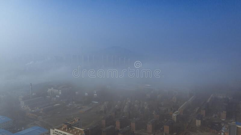 A city in the fog, shot in Dalian Liaoning China. A city in the fog, shot in Dalian, Liaoning, China stock photo