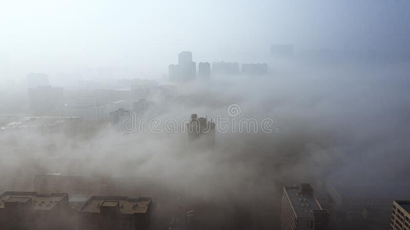 A city in the fog, shot in Dalian Liaoning China. A city in the fog, shot in Dalian, Liaoning, China royalty free stock photos