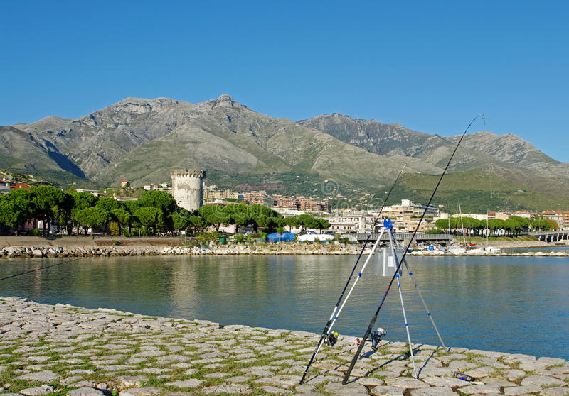 The city of Formia Italy seen from its harbor. Behind the fishing gear you see the City of Formia stock photography