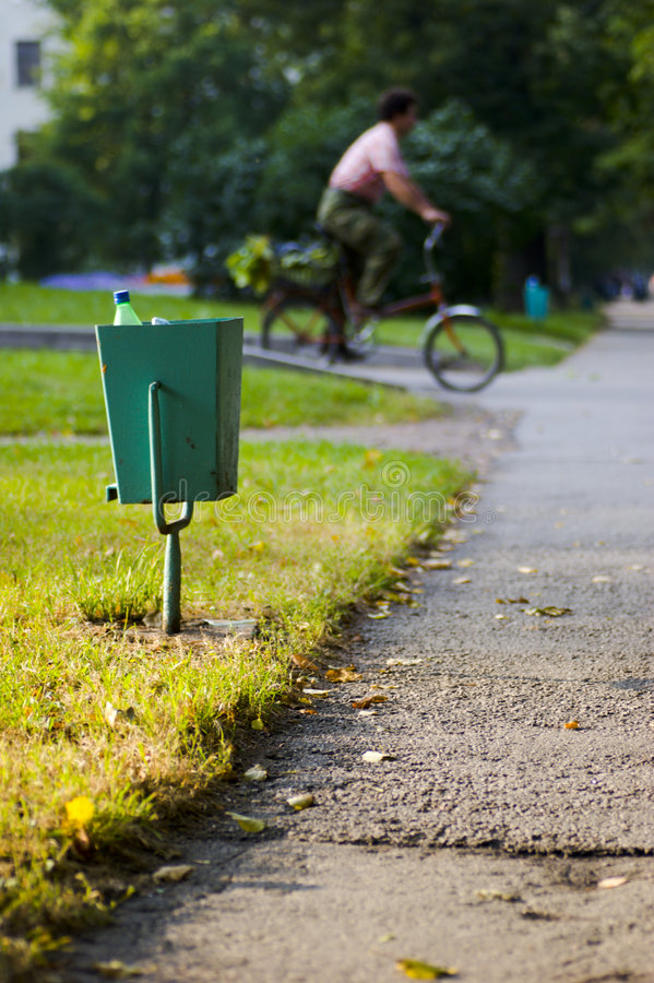 City garbage bin and cyclist royalty free stock images