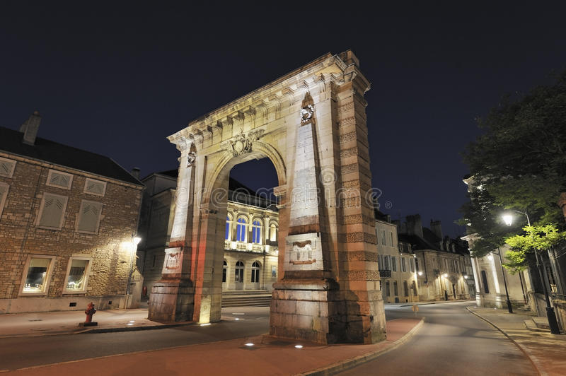 City gate in Beaune, France. Porte St Nicholas at night in Beaune, France stock images