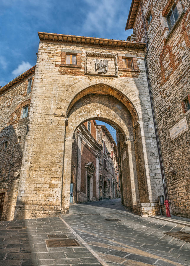 City gate in Todi, Italy. The ancient city gate Porta Catena in the medieval town Todi, Umbria , Italy stock images