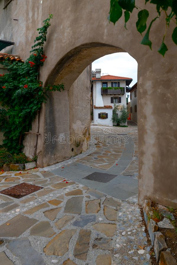 City gates leading into the Main Square in Historic medieval town of Smartno in Goriska Brda, Slovenia with narrov. Streets leading into the town. Due strategic stock images