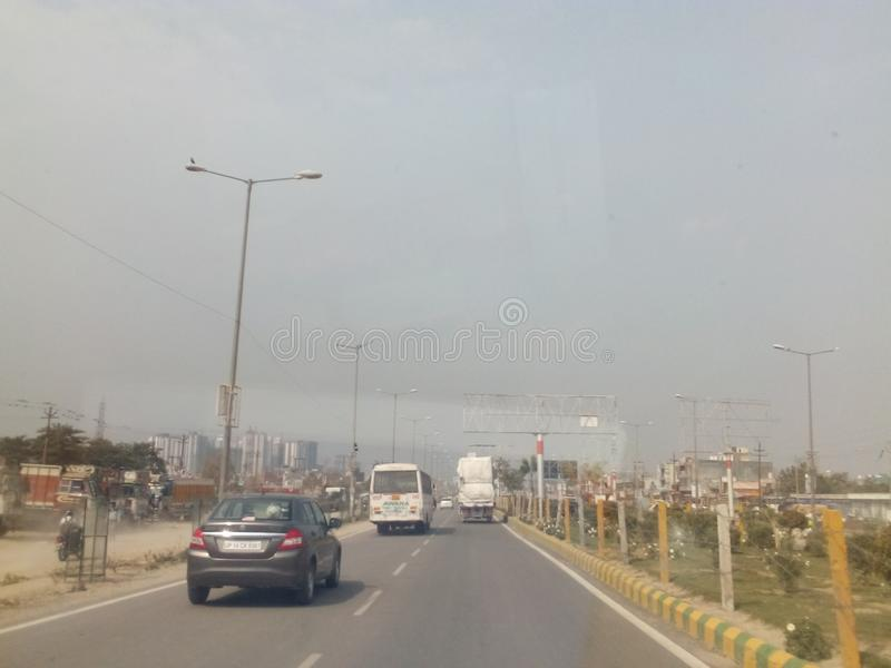 City ghaziabad. City scrape in the afternoon,ghaziabad, india . A scenic design of roadway in the modern growing City. The afternoon sky is light and sanguine royalty free stock photos