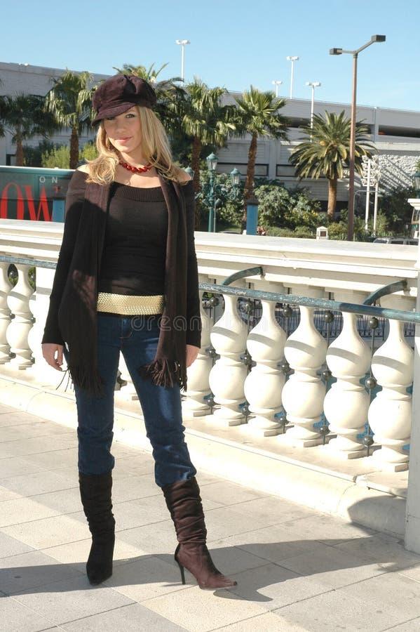City Girl. Beautiful Woman standing on a bridge with winter fashion on. Fashion Woman royalty free stock image