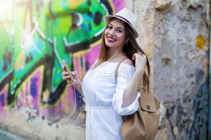 City girl listening to music with her smartphone royalty free stock images