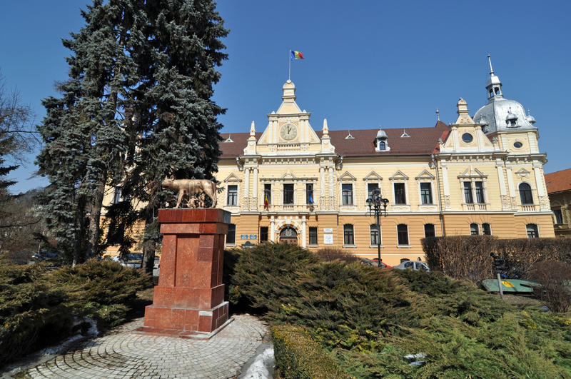 City hall Brasov. City hall of Brasov city and wolf statue in Transylvania land of Romania royalty free stock photos