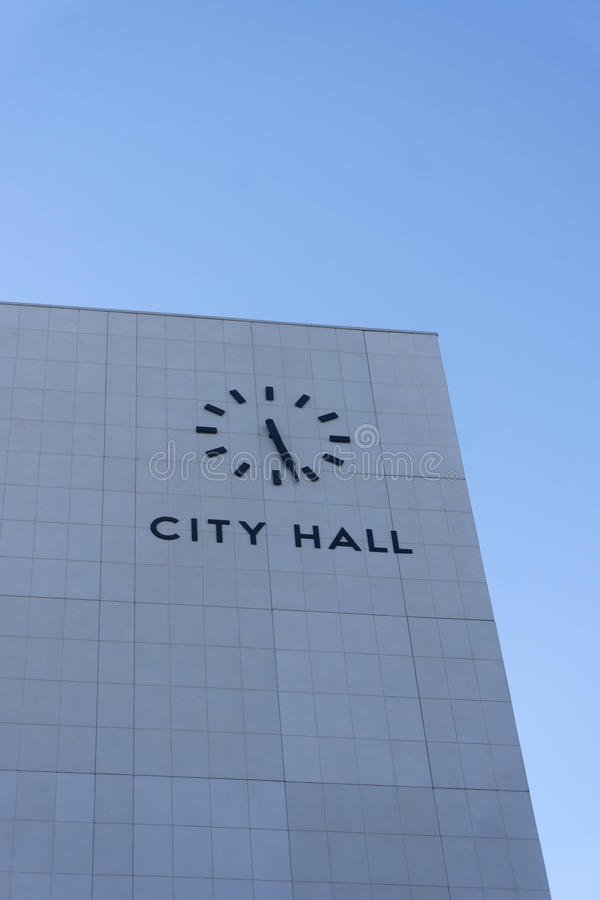 City Hall building with clock stock photography