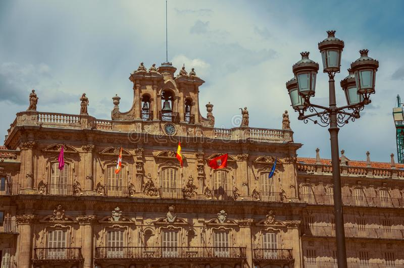 City Hall building with and public lamp at Salamanca. City Hall building facade at the Plaza Mayor, with baroque ornaments and public lamp at Salamanca. This stock photos