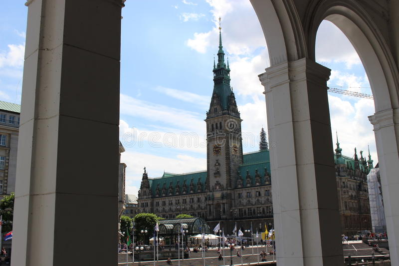 "The city hall of Hamburg in Germany, Europe. Seen through the arcades of the ""Old Rampart"" or ""Alter Wall royalty free stock photography"