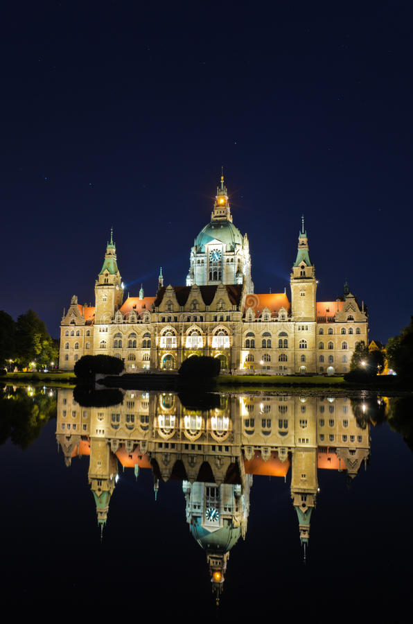 City Hall of Hannover, Germany by night. With stars and reflection in a lake royalty free stock image