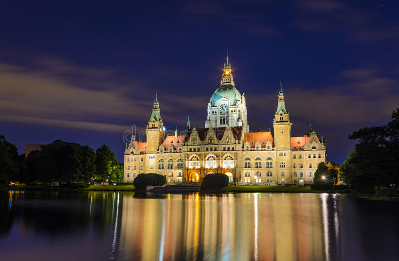 City Hall of Hannover, Germany by night. With cloudy sky and reflection in a lake royalty free stock photo