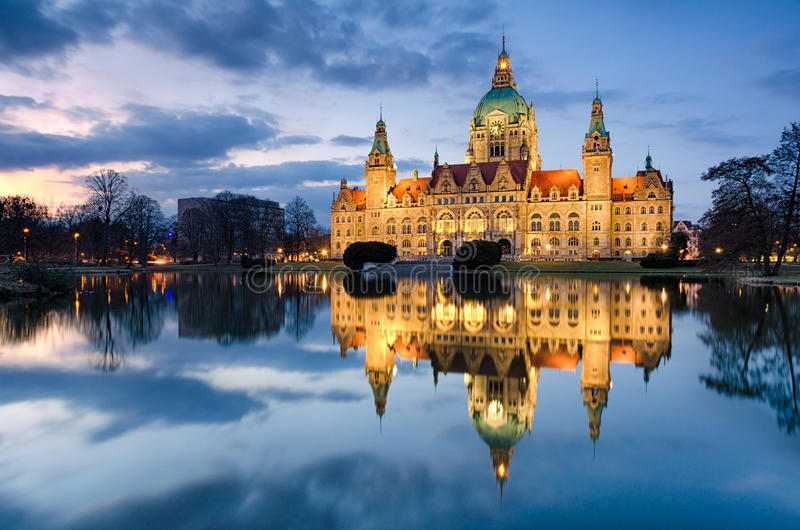 City Hall of Hannover, Germany by night. With cloudy sky and reflection in a lake royalty free stock images