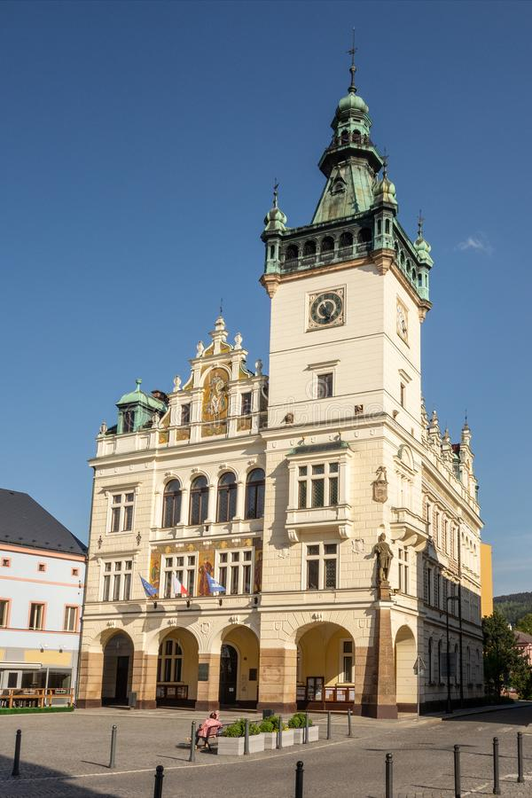 City hall in Nachod city in Czech Republic. With a high tower during sunny day with empty town square stock image