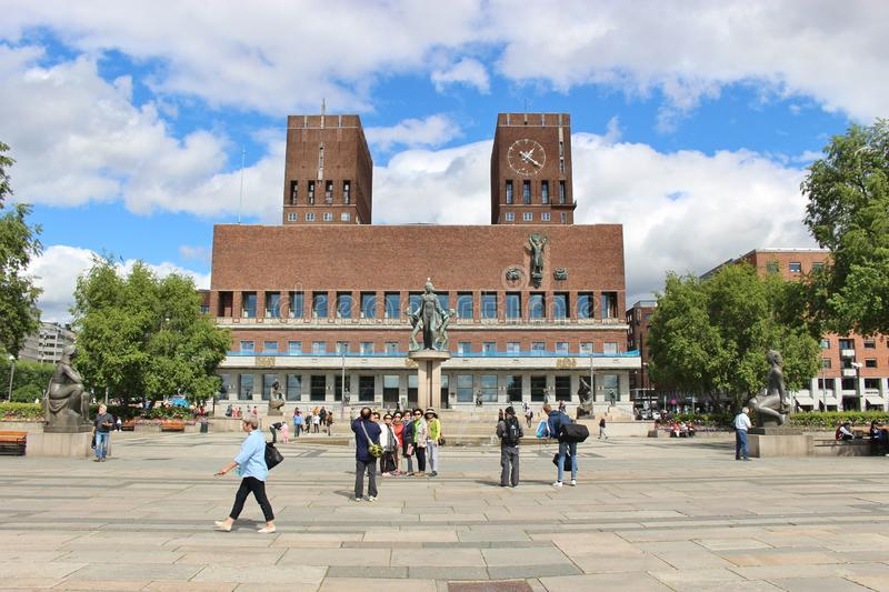 The City Hall of Oslo, Norway, Scandinavia, Europe. Tourists are posing in front of the building. Photo taken in August 2015 stock photo